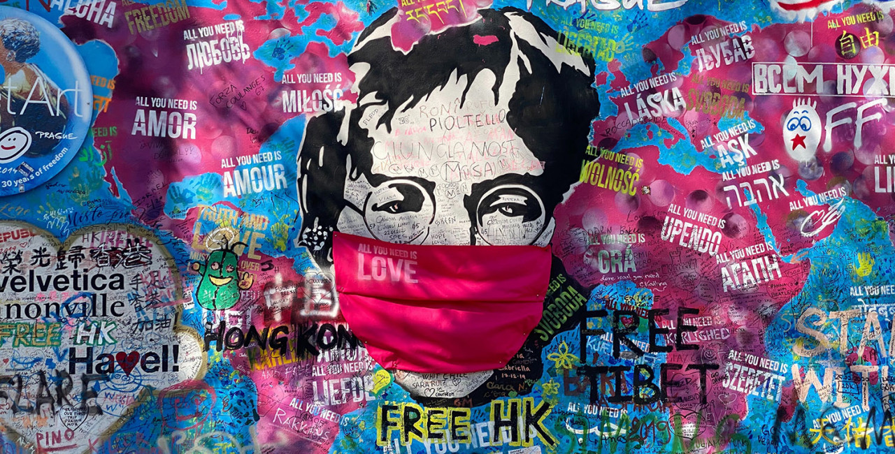 Even Prague's Lennon Wall has donned a face mask. Photo via Lucas Nemec