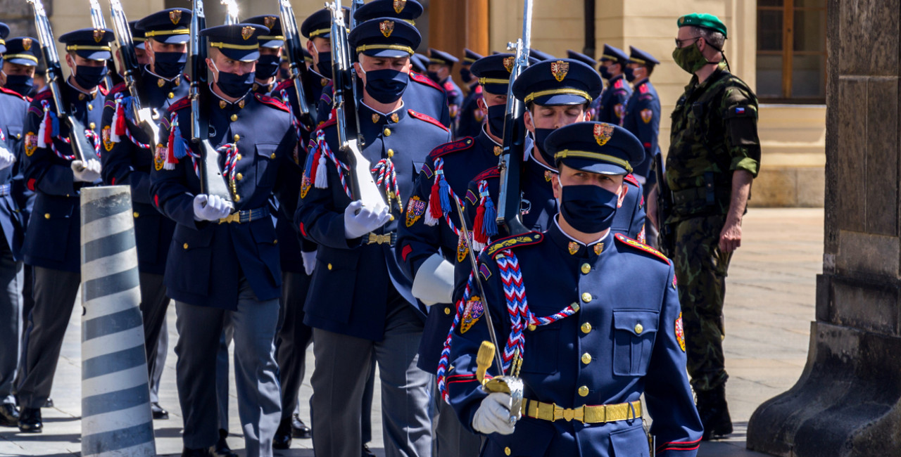 Soldiers at Prague Castle wearing face masks during the changing of the guard via iStock / josefkubes