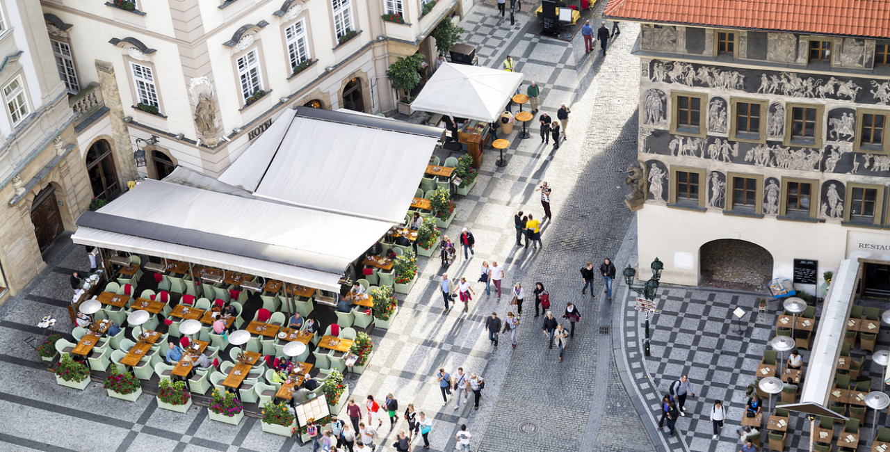 Outdoor seating areas at restaurants in Prague's Old Town