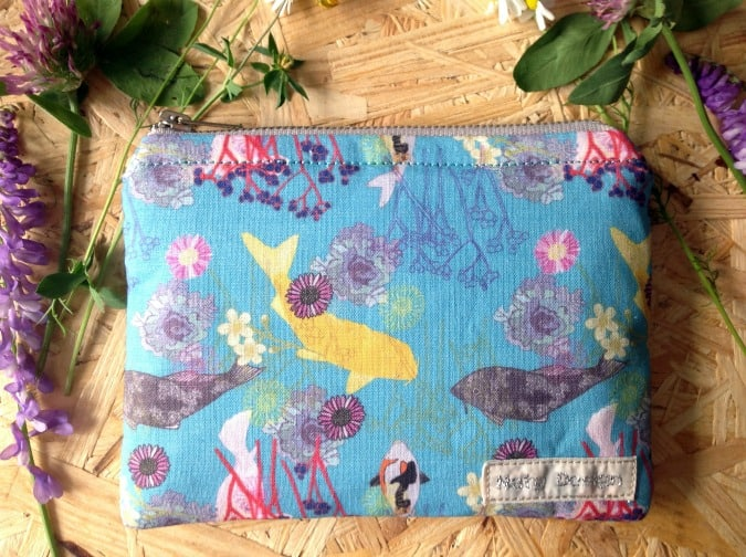 Purse with fish design on wood background