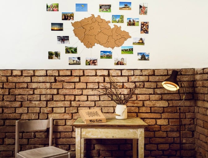Cork board map shaped like the Czech republic hanging on a wall