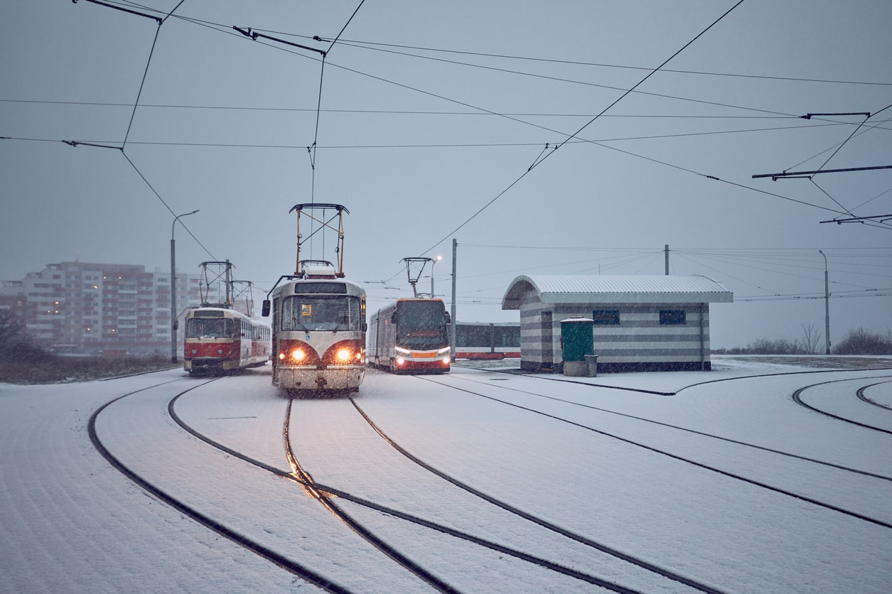 Trams make tracks through heavy snowfall outside Prague's city center.
