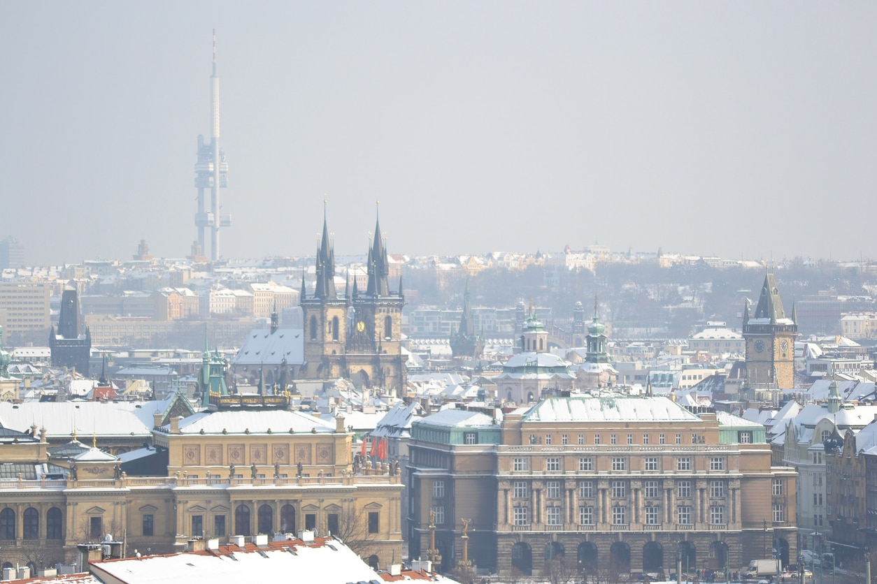 Prague's Old Town district with a light dusting of snow, the TV Tower in the distant background.