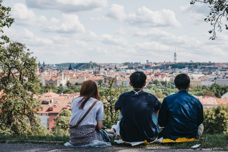 People enjoying the view of Prague from Petřín Hill