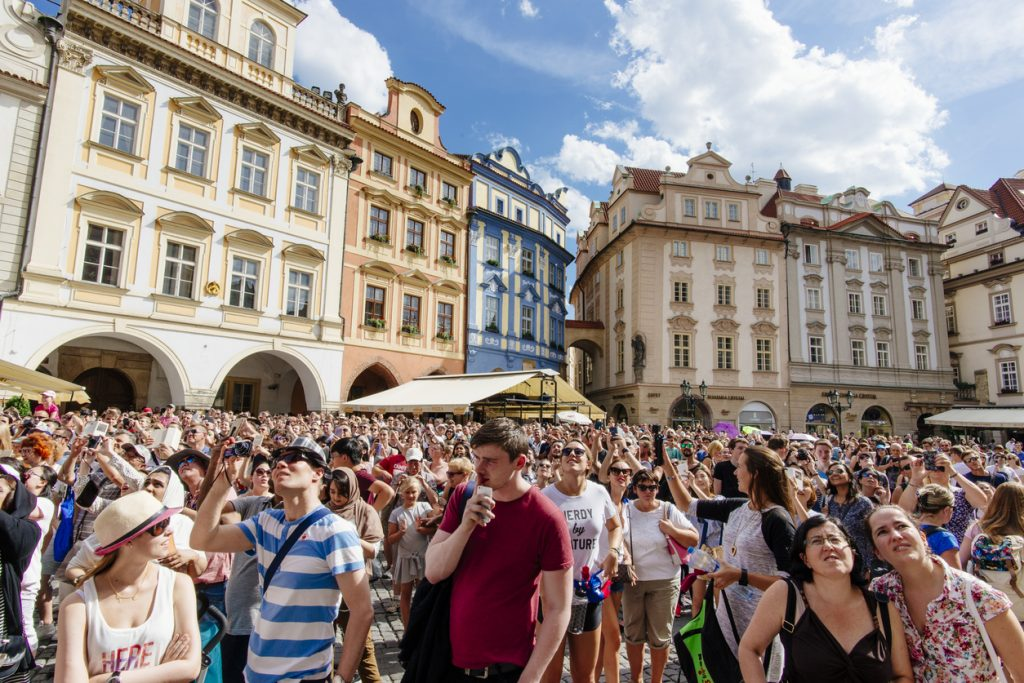 Thousands of tourists flood Prague's Old Town Square during the summer season