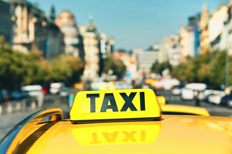The taxi cars waiting for customers. Wenceslas Square in Prague, Czech Republic. - selective focus
