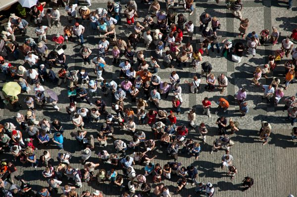 A crowd of people in Prague's Old Town Square