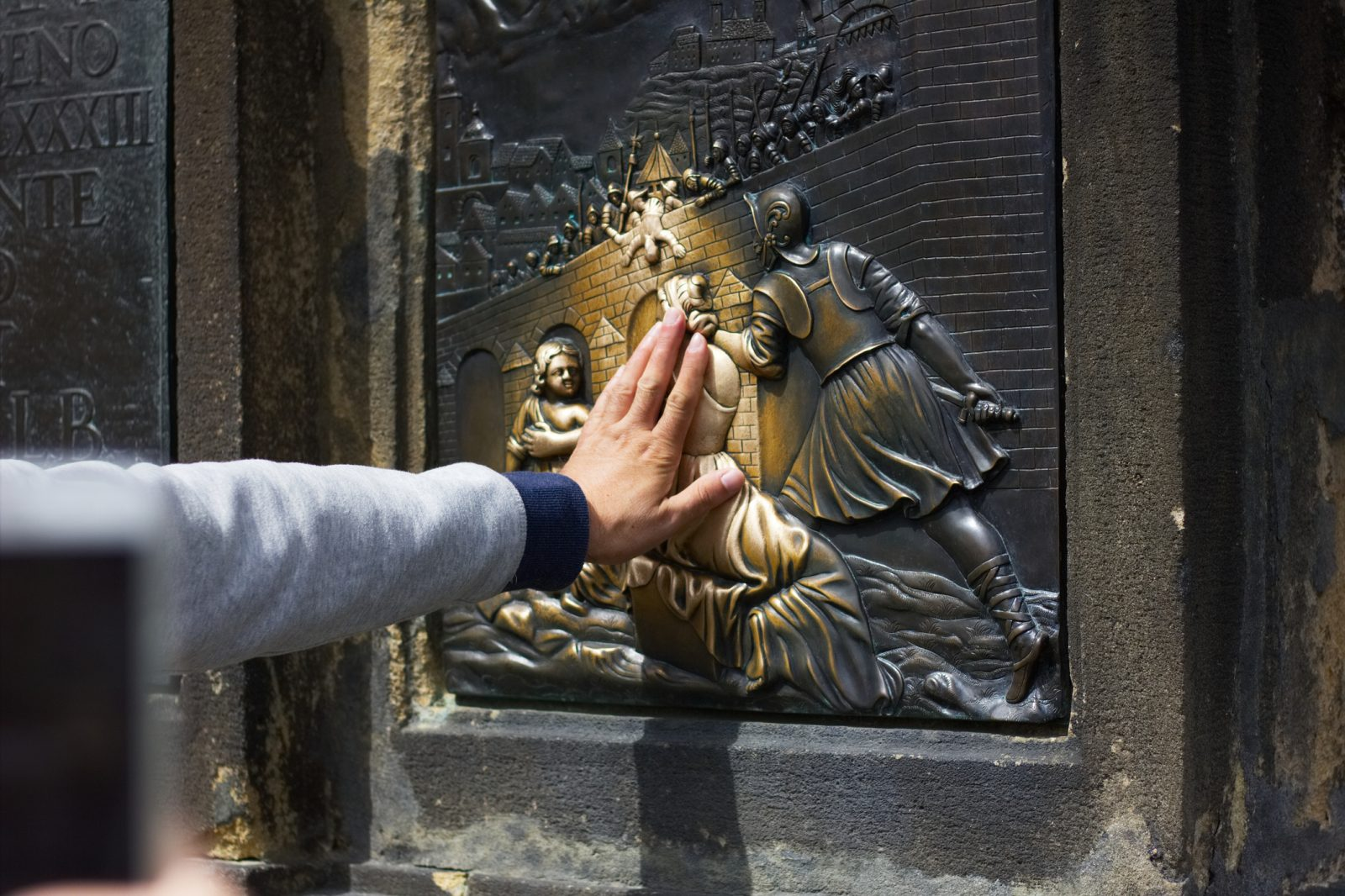 Touching Prague statues and other tourist rituals may be too 'hands-on' for your health, say scientists