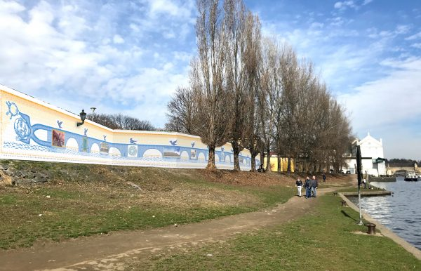 "Prague gets a new ""bridge"": a 70-meter-long wall mural by world-renowned Czech illustrator Peter Sís"