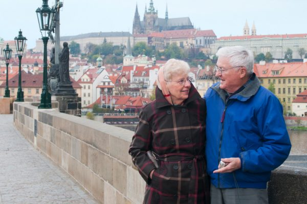 An elderly couple on Prague's Charles Bridge