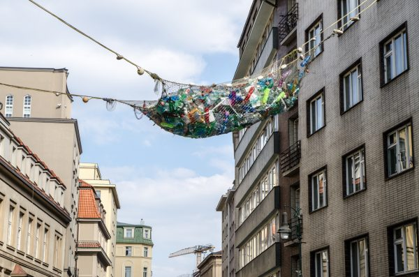 An art exhibit above Prague's Dlouhá street depicts a fishing net full of plastic waste