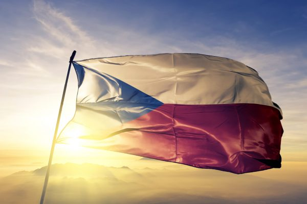 Czech flag at sunrise via iStock.com / Oleksii Liskonih