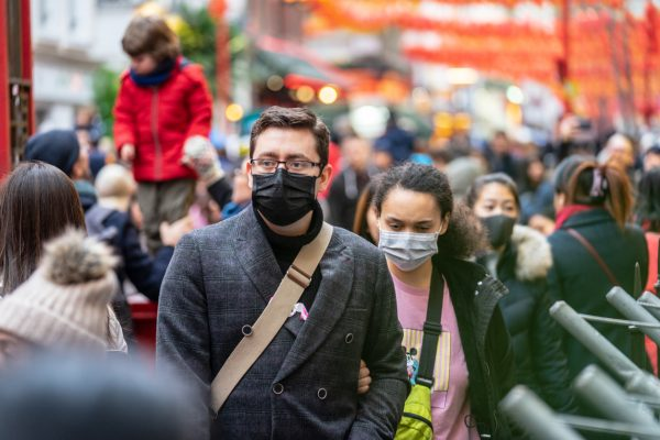 London, January 26, 2020: People wearing protective face masks (illustrative photo via iStock.com / Powerofflowers)