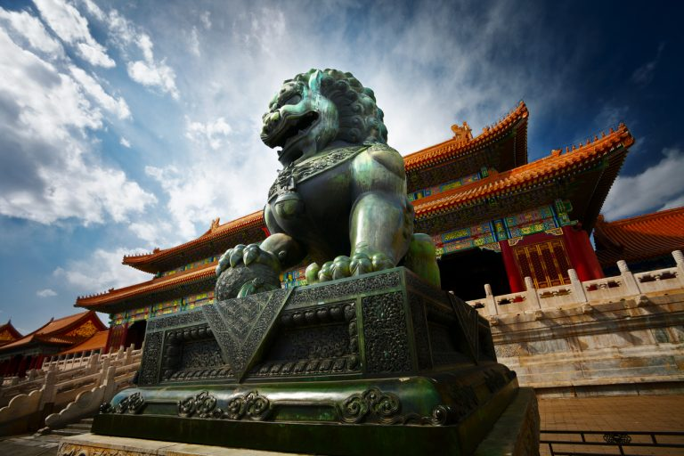 Bronze lion at the Forbidden City in Beijing, China via iStock.com / ithinksky