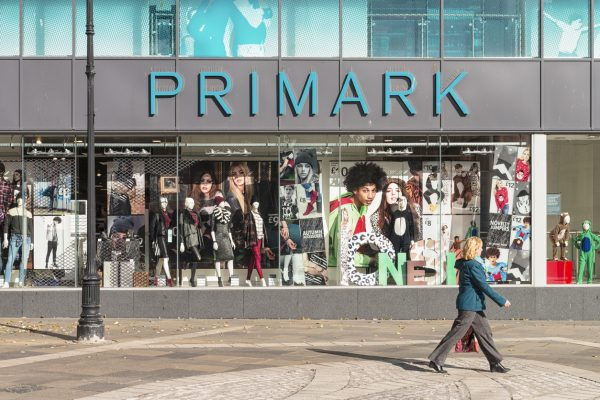 A woman walks past a Primark in Dundee, UK (illustrative image via iStock.com / georgeclerk)