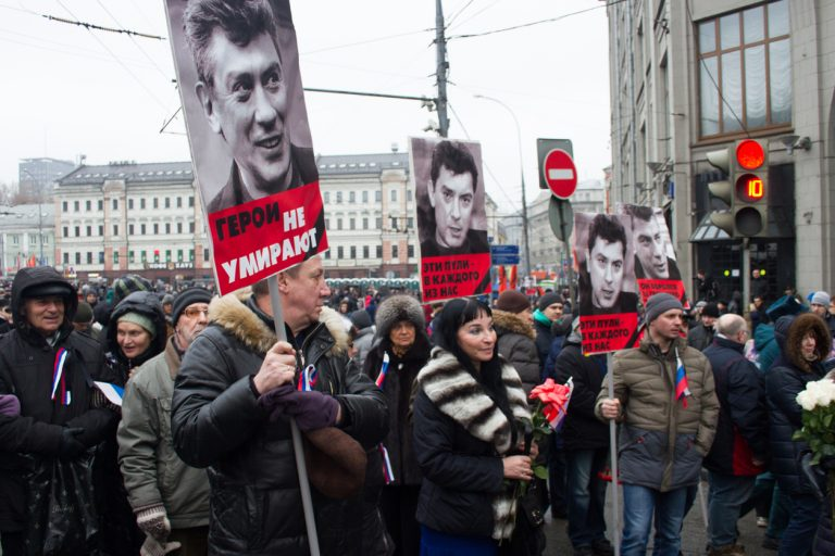 Moscow, Russia - March 1, 2015. Nemtsov's portraits on mourning march of memory via iStock.com / olegkozyrev