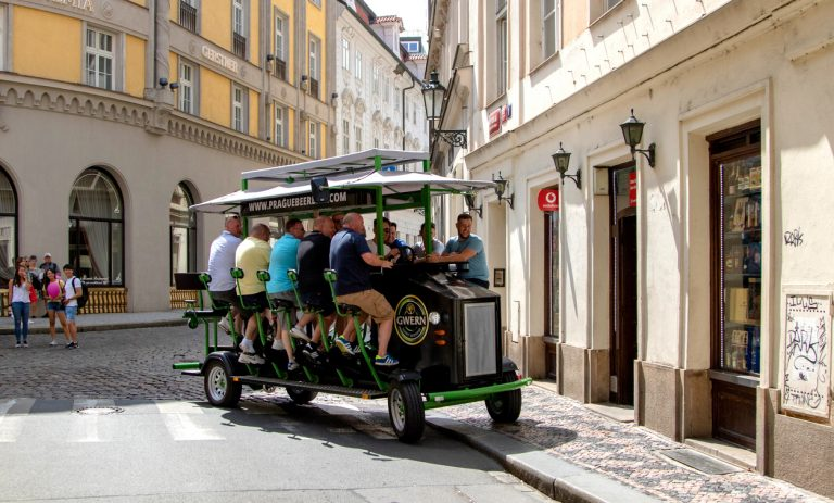 Prague, June 2019 - people pedal through the city on a Beer Bike (via iStock.com / Photoservice)