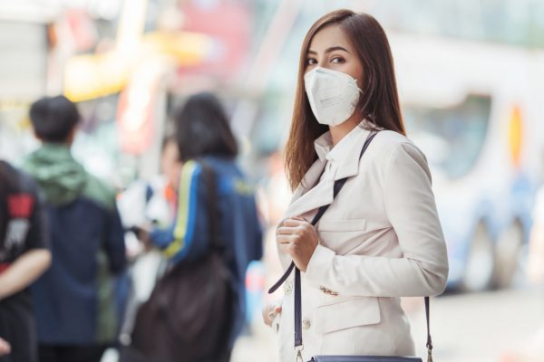 Woman wearing a face mask. Illustrative photo via iStock / torwai