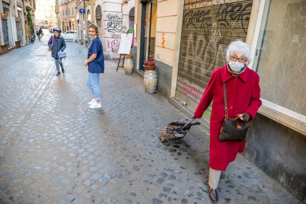 Rome, Italy, March 11 -- An senior lady protected by a medical mask goes shopping. Illustrative image via iStock / Photo Beto