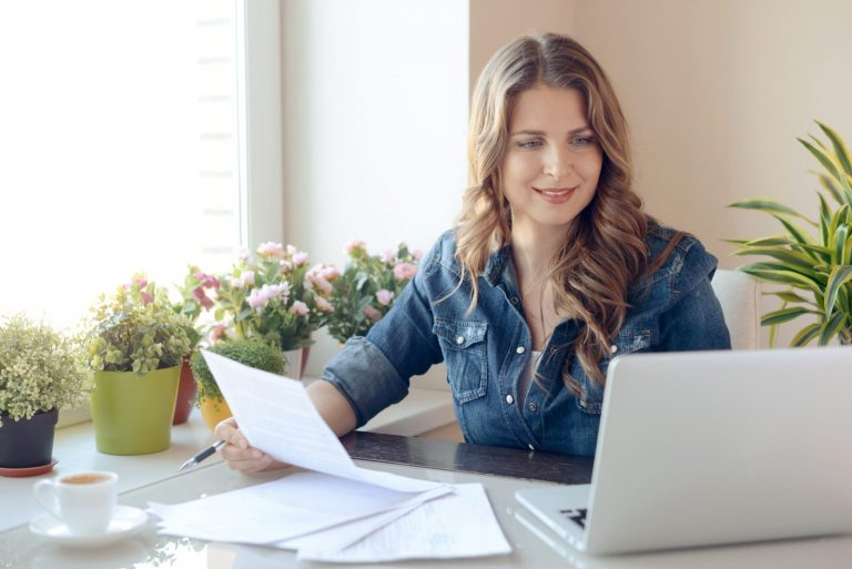 young beatiful woman working at home on computer