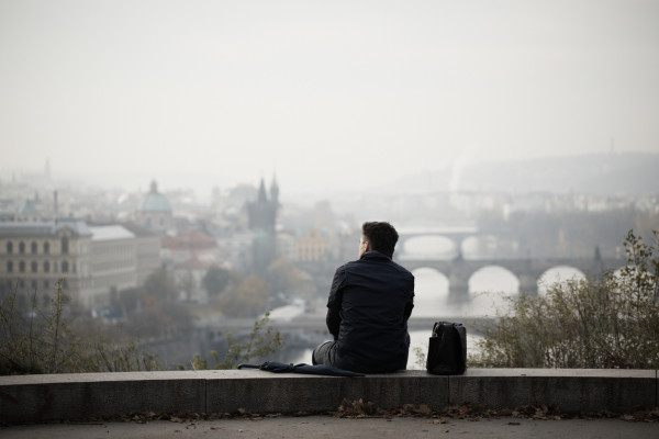 Man overlooking Prague via iStock / Chalabala