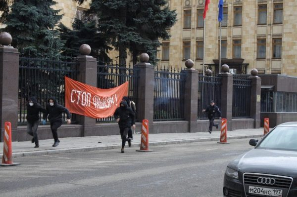 Russian extremists run from police outside the Czech embassy in Moscow. Photo via The Other Russia