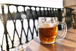 A fresh pint of Staropramen beer by the Vltava in Prague via Sonja Maric from Pexels