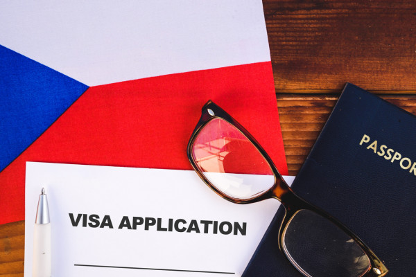 Flag of Czech Republic , visa application form and passport on table via iStock / mirsad sarajlic