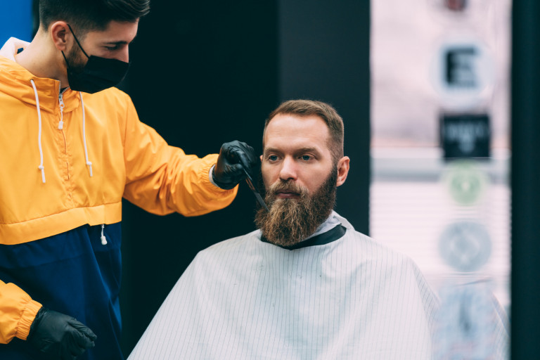 Barber with face mask and gloves via iStock / martin-dm