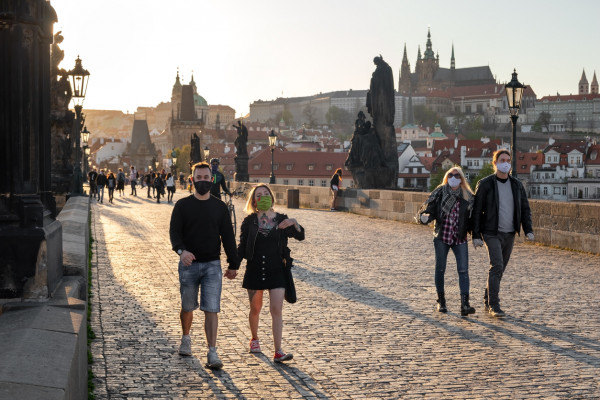 People wearing face masks on Prague's Charles Bridge during the coronavirus pandemic via iStock / Madeleine_Steinbach