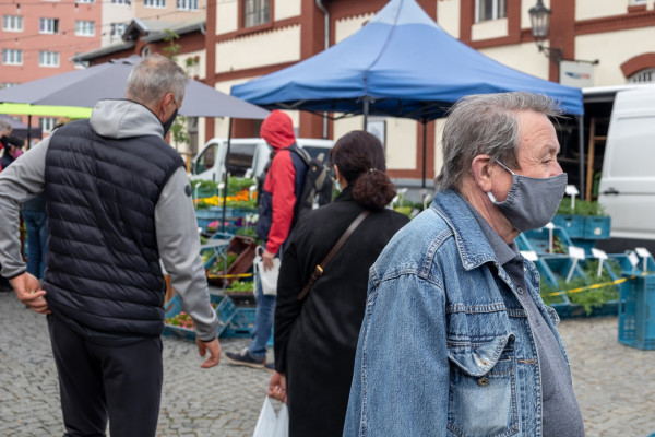 A man wearing a face mask at Prague's Holešovice farmers market via iStock / Madeleine_Steinbach
