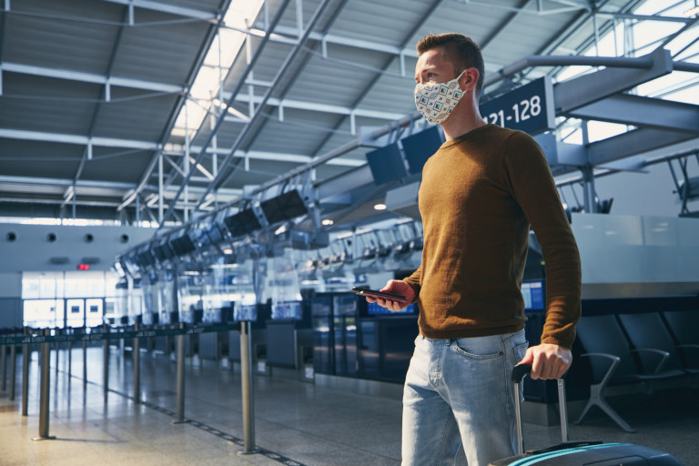 A passenger wearing a face mask walking though the Prague Airport. Photo: Prague Airport