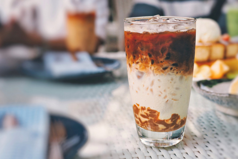 Illustrative image of iced coffee on a cafe table