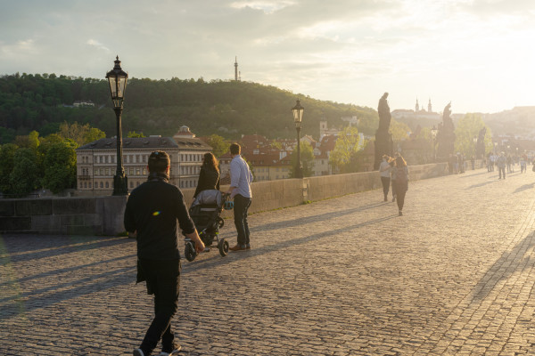 People wearing face masks on Prague's Charles Bridge via iStock / hopsalka