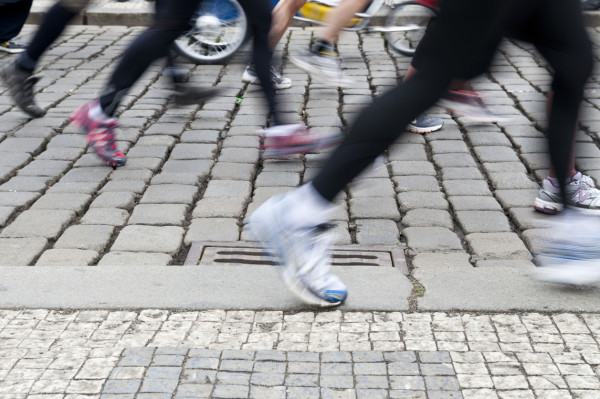 Marathon runners on Prague cobblestones via iStock / Beba73