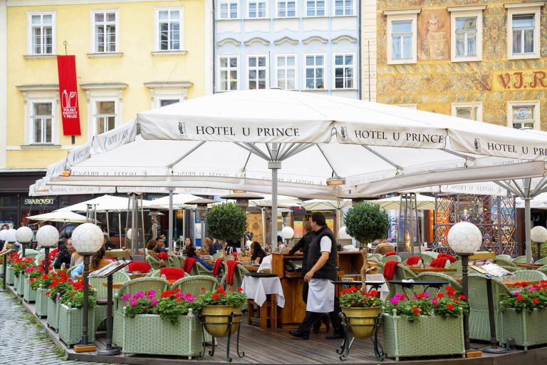 Outdoor dining area at Hotel U Prince on Prague's Old Town Square, 2014 via iStock / Bim