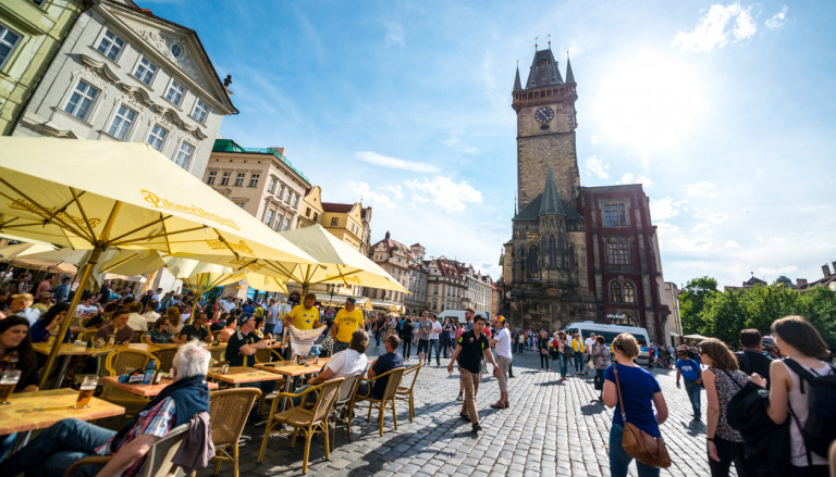 Tourists in Prague's Old Town Square enjoying a beer in 2015 via iStock / anouchka
