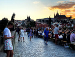 Prague residents symbolically said goodbye to the coronavirus crisis last night with a mass dinner on Charles Bridge. Photo via Jason Pirodsky