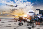 Passenger aircraft preparing for flight via iStock / guvendemir