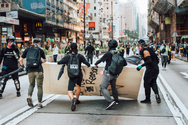 Protesters on the streets of Kowloon, Hong Kong in October 2019 via iStock / Nikada
