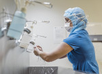 Nurse with face mask washing hands via iStock / HRAUN