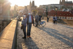 People wearing face masks on Prague's Charles Bridge at the height of the epidemic in April via iStock / Madeleine_Steinbach