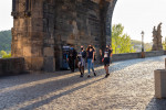 People wearing face masks on a mostly-empty Charles Bridge in Prague in April via iStock / Madeleine_Steinbach