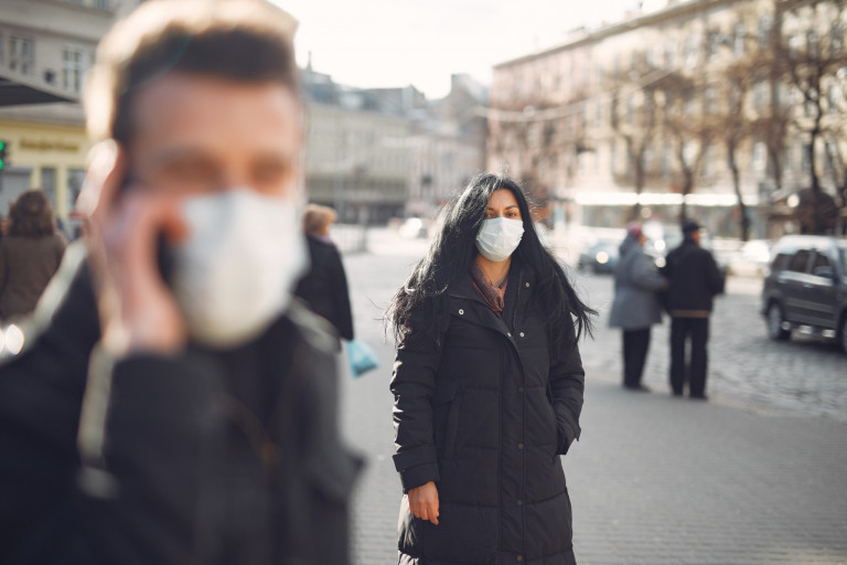 A woman wearing a face mask.