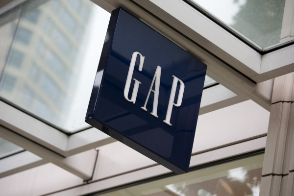 Seattle, Washington, USA - May 27, 2012: The logo and word mark of Gap, mounted above the entrance to the store in downtown Seattle